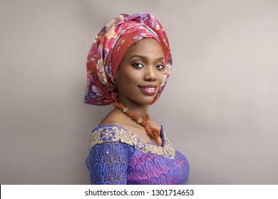 A Smiling  lady  in Traditional African Attire