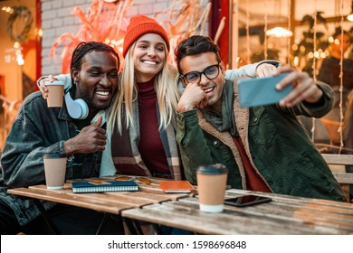 Smiling lady and two guys making selfie outdoors stock photo