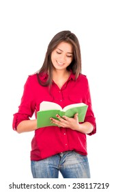 Smiling Latin college Girl reading big green book