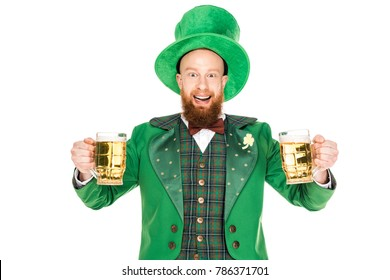 smiling leprechaun celebrating st patricks day with glasses of beer, isolated on white
