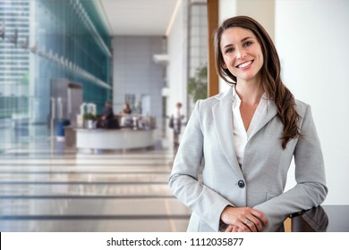 Smiling likable sincere and charming business woman financial executive type portrait inside commercial building