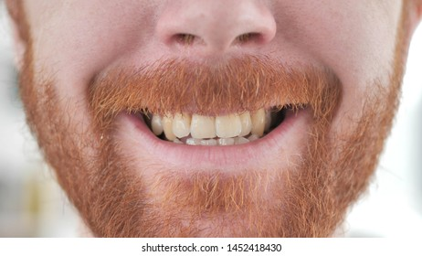 Smiling Lips of Young Casual Redhead Man