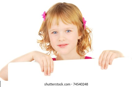 Smiling little adorable  girl holding empty white board isolated on the white.
