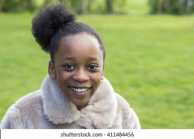 Smiling little African girl looking at eh camera