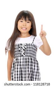 Smiling little asian girl rise hand and pointing