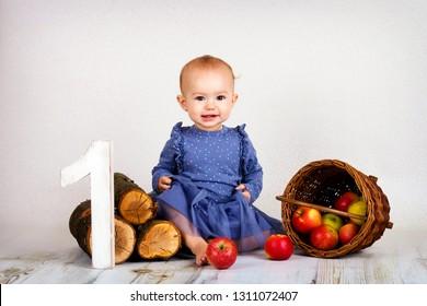 Smiling little baby girl celebrating first birhtday