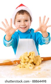Smiling little boy with Christmas cooking, isolated on white