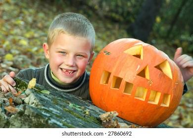 Smiling little boy with halloween pumpkin