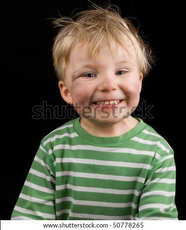 Smiling Little Boy On Black Background Stock Photo Edit Now
