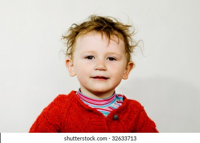 A smiling little boy on the light background
