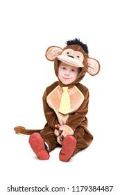 Smiling little boy wearing like monkey. Isolated on white