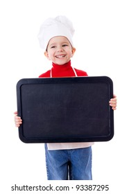 Smiling little cooker with empty horizontal chalkboard, isolated on white