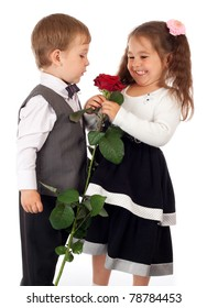 Smiling little girl with boy and red rose