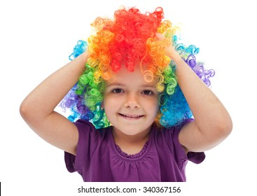 Smiling little girl with clown hair - portrait isolated on white