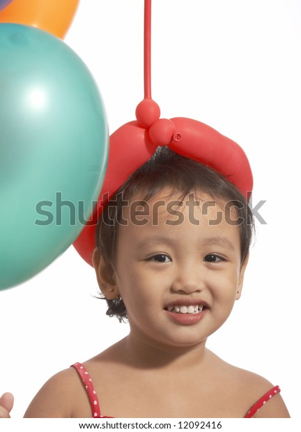 smiling little girl and her colorful balloons