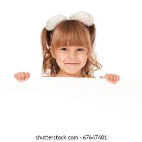 Smiling little girl holding empty white board
