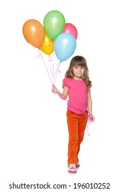 A smiling little girl holds balloons against the white background