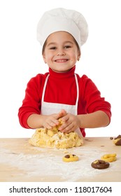 Smiling little girl kneading the dough for cookies, isolated on white