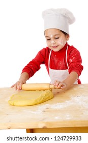 Smiling little girl kneading the dough, isolated on white