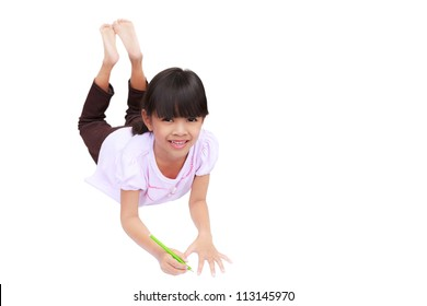 A smiling little girl is lying on the floor, Isolated on white with clipping path