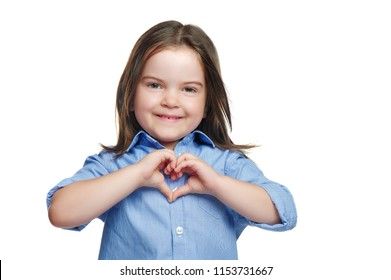 Smiling little girl making heart with hands isolated on white background