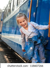 Smiling little girl on train