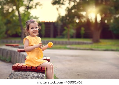 Smiling little girl playing in the park.Selective focus and small depth of field.