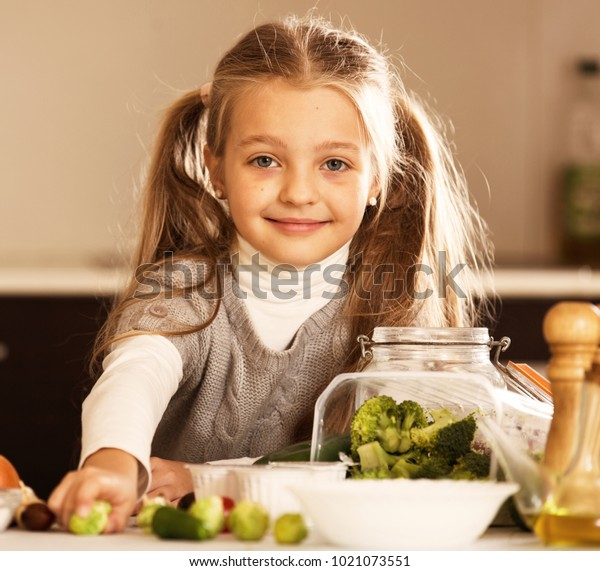 Tremendous Smiling Little Girl Ponytails Cooking Vegetable Stock Photo Edit Schematic Wiring Diagrams Phreekkolirunnerswayorg
