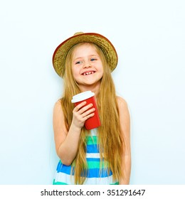 Smiling little girl portrait in hipster style with red coffee glass. Yellow hat wearing. Isolated white background.