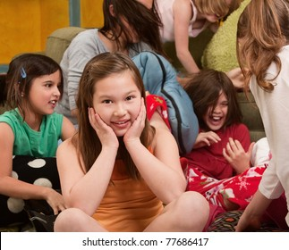 Smiling little girl at a sleepover with her friends