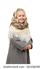 A smiling little girl in traditional Russian kerchief, isolated on white background