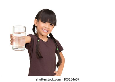 Smiling little girl with a water glass on white background