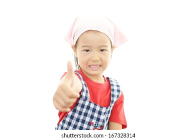 Smiling Little Girl Wearing Apron