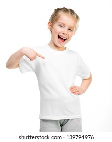 Smiling little girl in white t-shirt over white background
