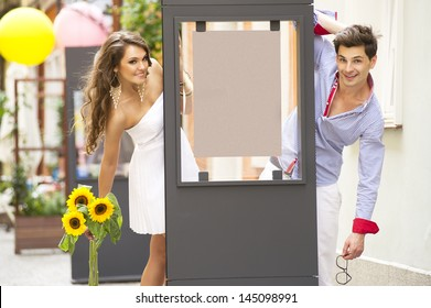 Smiling lovely couple with board
