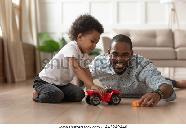Smiling Loving African American Dad Lying Stock Photo (Edit