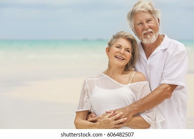 Smiling loving Caucasian senior retired couple in white casual clothes together on luxury Caribbean vacation beach