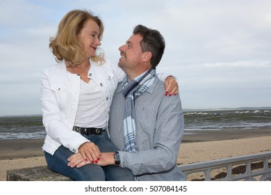 Smiling and loving couple on vacation, looking at each other