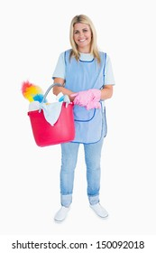 Smiling maid holding a pink bucket in the white background