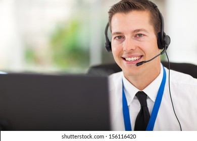 smiling male customer support operator with headset