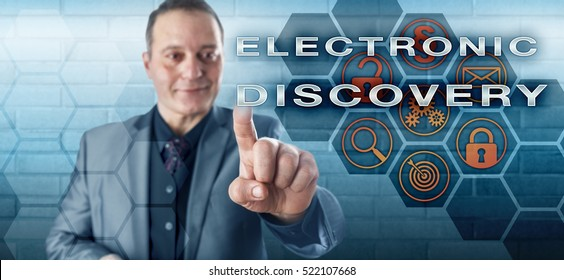 Smiling male governmental investigator pushing ELECTRONIC DISCOVERY on an interactive touch screen. Information technology concept touching on litigation, digital evidence, email and civil procedure.