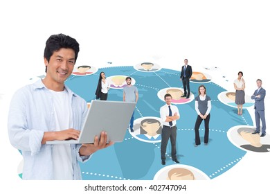 Smiling male with his laptop against online community