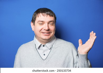 Smiling male with his palm up