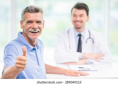 Smiling male patient sitting at doctor's office and looking at camera.