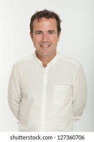 Smiling Male portrait with white shirt on a neutral background