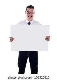 Smiling male representative holding blank signboard