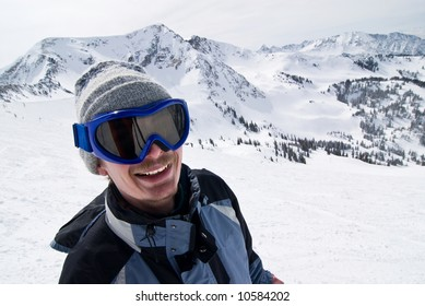 Smiling male skier with the Rockies in the background