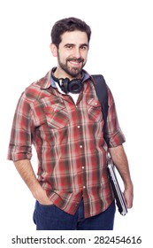 Smiling male student holding a laptop, isolated on white background