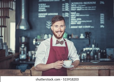 Smiling man in a cafe