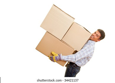 Smiling man carrying heavy boxes